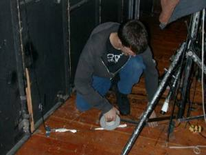Joe taping down a cord