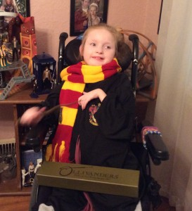 Caitlin Thomas in a wheelchair, wrapped in a Hogwarts scarf