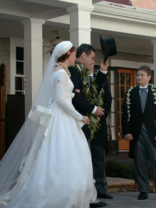 Mary Robinette and Robert Kowal walking in wedding dress and tophat.